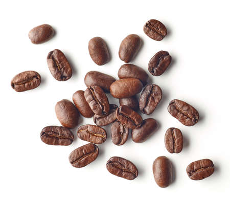 Foto de Heap of roasted coffee beans isolated on white background, top view - Imagen libre de derechos