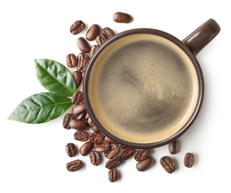 Foto de Cup of black coffee and beans with leaves isolated on white background, top view - Imagen libre de derechos