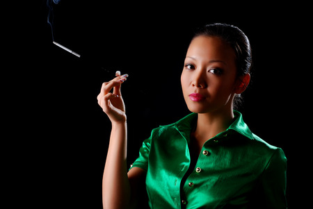 portrait of a beautiful young woman with cigarette