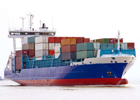 container ship sailing into port