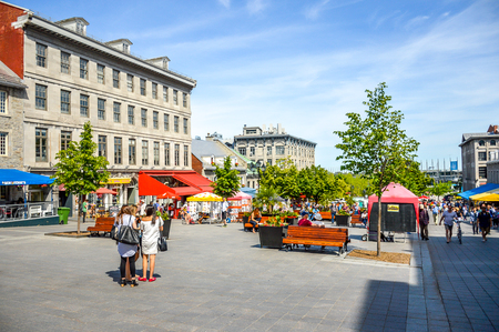 Montreal, Canada - June 15, 2017: Tourists on Jacques Cartier place.Place Jacques-Cartier is a square located in Old Montreal and an entrance to the Old Port of Montreal. People can be seen around.