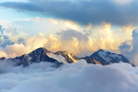 Photo for alpine landscape with peaks covered by snow and clouds - Royalty Free Image