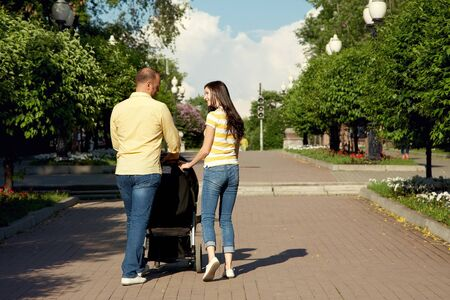 Photo for young parents for a walk with stroller - Royalty Free Image