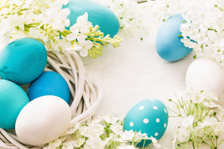 Photo for Easter decoration with eggs and flowers on white wooden background - Royalty Free Image