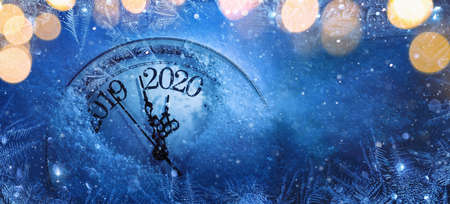 Photo pour Happy New Years 2020. Winter Celebration With Dial Clock On Snow And Light - image libre de droit