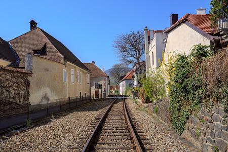 The railway through the fair municipality of Weissenkirchen in der Wachau. The District of Krems-Land, Lower Austria.