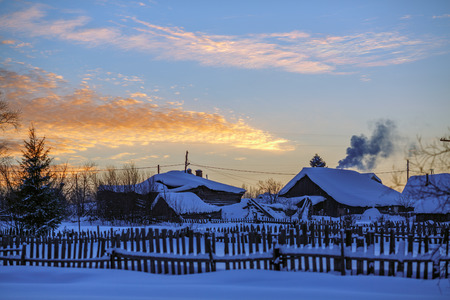 Russian old-believer village Visim in winter evening. The village is situated in the low Middle Ural Mountains of Sverdlovsk region, Russia