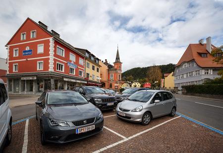 SPITTAL AN DER DRAU, AUSTRIA - OCTOBER 8, 2017. Car parking in the old town square. Town of Spittal an der Drau, Gurktal Alps (Nock Mountains), federal state of Carinthia, Austria.