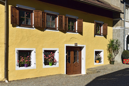 Beautiful old residential house decorated with flowers. Gmuend in Kaernten, district of Spittal an der Drau, federal state of Carinthia, Austria