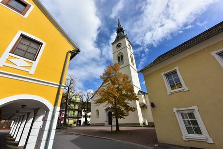 SPITTAL AN DER DRAU / AUSTRIA - OCTOBER 8, 2017. Old bell tower of the church Maria Verkuendigung in the historical downtown. Town of Spittal an der Drau, federal state of Carinthia, Austria.