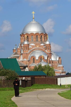 SVIYAZHSK, RUSSIA - AUGUST 20, 2019. Monk walking in front of Cathedral in honor of the Icon of the Mother of God. Convent of St. John the Forerunner, Sviyazhsk, Republic of Tatarstan, Russia.