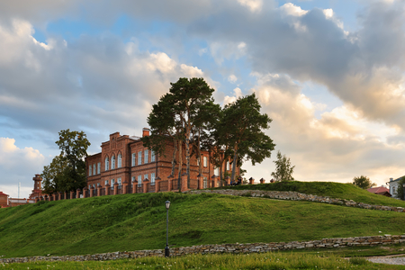 Secondary school buiding built in 19th century during sunset. UNESCO island town of Sviyazhsk, Republic of Tatarstan, Russia.