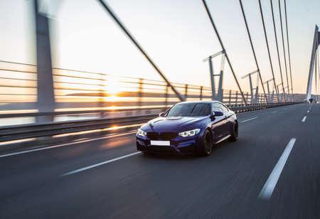 Photo for Business class black sedan driving on the bridge - Royalty Free Image