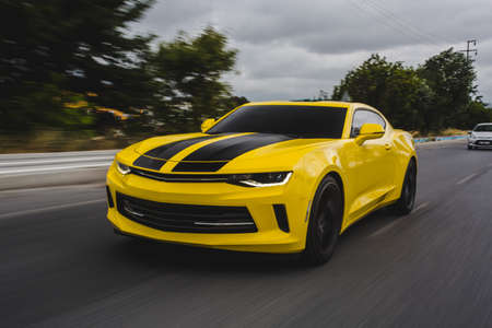 Photo for Yellow sport car with black tuning on it - Royalty Free Image