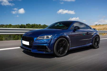 Photo for Blue luxury sedan car on the highway - Royalty Free Image