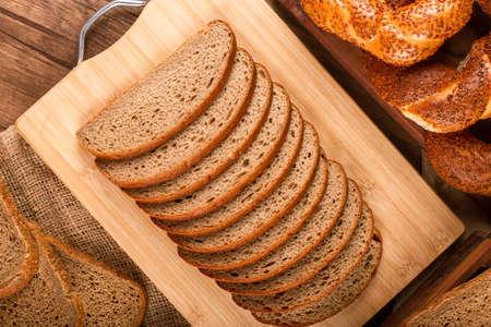 Foto für Slices of dark and white bread and turkish bagels on table - Lizenzfreies Bild