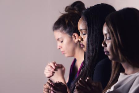 Three Dedicated Christian Ladies Praying To God