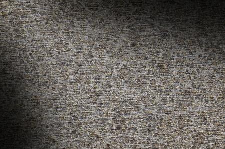 Closeup of gray rock texture surface lit diagonally