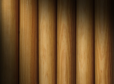 Wooden poles forming a background texture lit diagonally