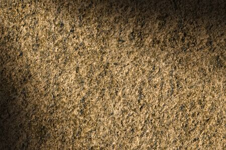 Granite rock stone background texture lit diagonally