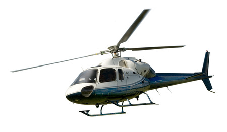 Blue and white helicopter in flight isolated against white background