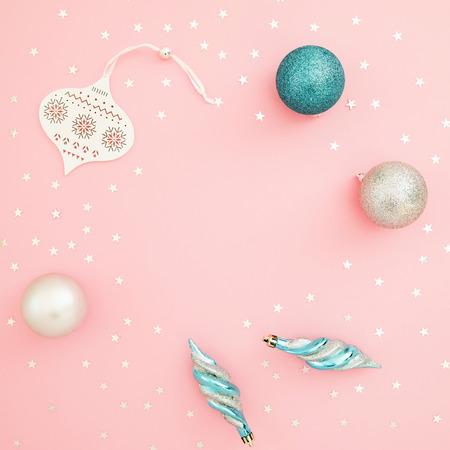 Foto de Christmas composition. Decoration and confetti on pink background. Flat lay, top view. Holidays concept - Imagen libre de derechos