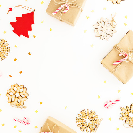 Christmas gifts on white background. Flat lay, top view. Christmas frame composition