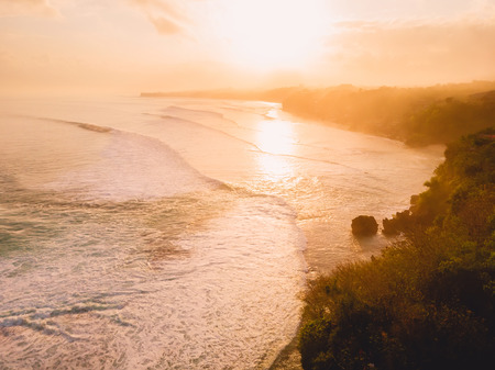 Photo for Aerial view of stormy waves at warm sunrise and sandy beach - Royalty Free Image