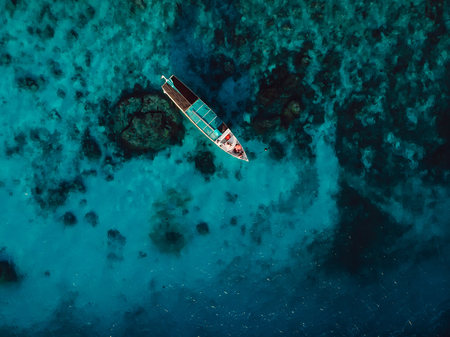 Photo for Tour boat at the in blue ocean on Gili island. Aerial view. - Royalty Free Image