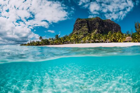 Photo pour Tropical crystal ocean with Le Morne mountain and luxury beach in Mauritius. Split view. - image libre de droit
