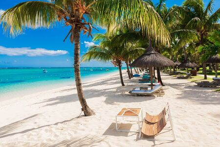 Photo pour Chairs and umbrella at paradise beach. Tropical holiday banner with ocean - image libre de droit