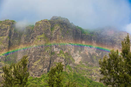 Colorful rainbow and Le Morn brabant mountain in Mauritius