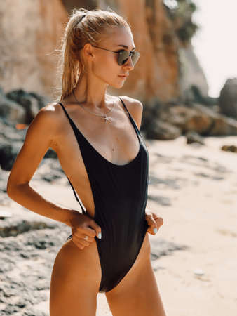 Photo pour Attractive slim woman in bikini relax at beach in Bali. Caucasian model with ocean - image libre de droit