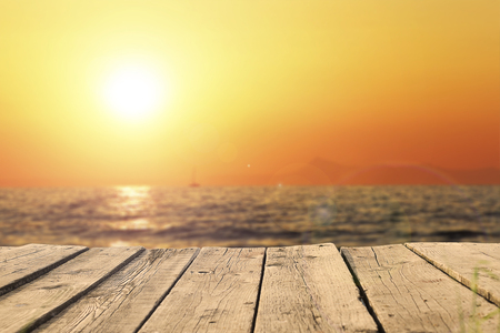 Photo pour old wooden pier on the sea in  sunset - image libre de droit