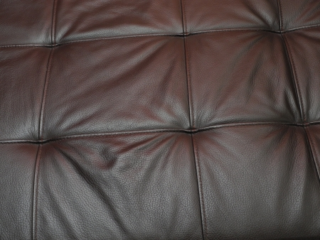Detail of the sample coated with leather sofas in the living room.