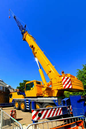 Big and yellow construction crane for heavy lifting