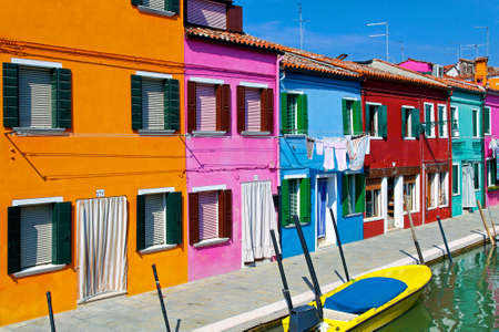 Colorful buildings in Burano island street canal