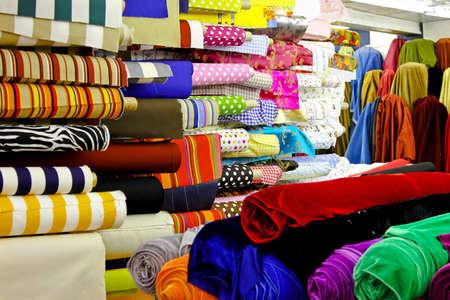 Photo pour Assortment of colourful textile fabric rolls in warehouse  - image libre de droit