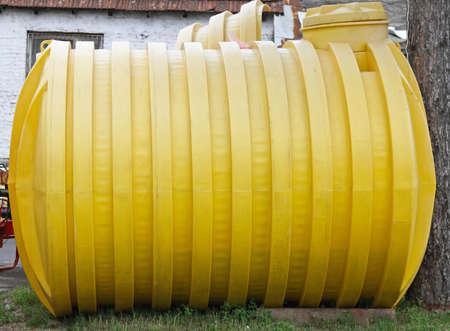Plastic yellow storage tank for underground installation