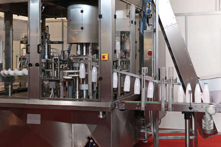 Photo pour Dairy packaging and filling systems in milk factory - image libre de droit