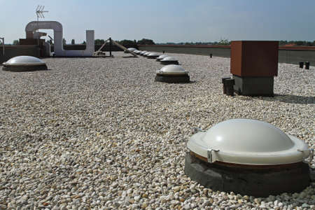 Photo for Flat roof with gravel and sky light windoows - Royalty Free Image