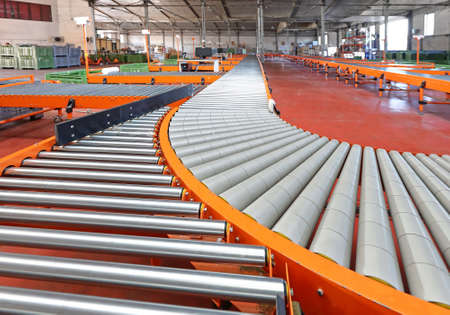 Photo pour Conveyor Roller Sorting System in Distribution Warehouse - image libre de droit