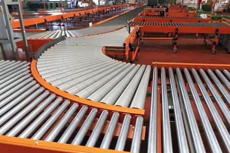 Photo pour Conveyor Rollers Sorting System in Fulfilment Center Warehousee - image libre de droit