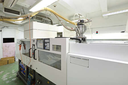 Photo pour DVD and CD Manufacturing Machine in Factory - image libre de droit