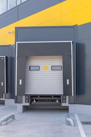 Photo pour Loading Dock Cargo Door at Distribution Warehouse - image libre de droit