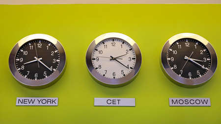 Photo for Central European Time Three Clocks at Wall Business - Royalty Free Image