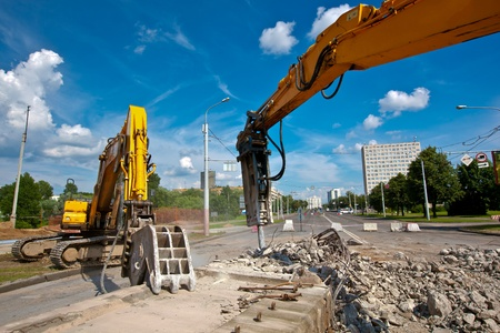 Concrete Crusher and Hydraulic Crushing Hammer demolishing reinforced concrete structures