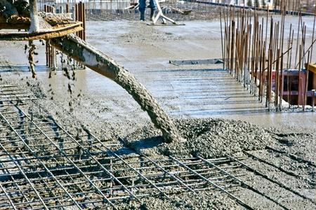 Foto für Concrete pouring during commercial concreting floors of buildings at construction site - Lizenzfreies Bild
