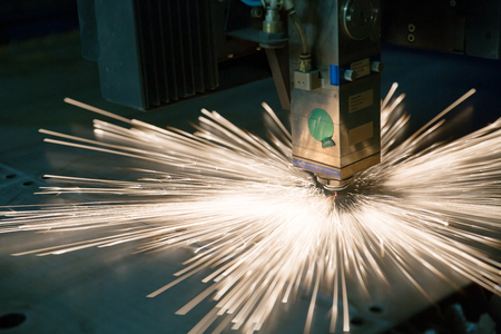 Industrial laser during cutting metal works