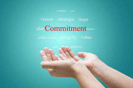 Businessman Hand Showing commitment Word